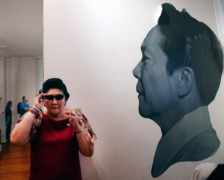 DARK PAST. In this file photo, former first lady Imelda Marcos stands next to a portrait of her late husband and President Ferdinand Marcos in Paoay, Ilocos Norte, on May 5, 2013. File photo by EPA/DENNIS M. SABANGAN