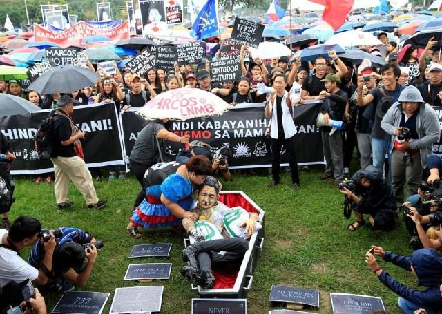 Protesters brave rains at Luneta rally vs. Marcos burial